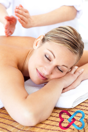 linking: Attractive woman receiving a tapping massage  against linking hearts