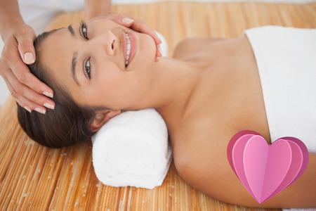 turning table: Beautiful brunette enjoying a head massage against heart