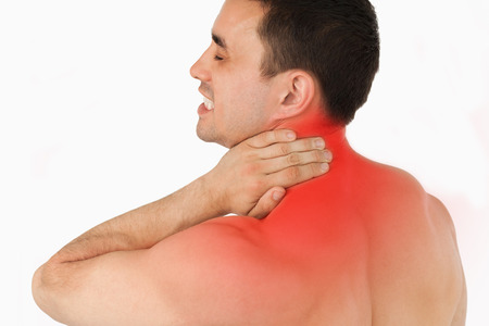 backpain: Young man suffering from neck pain Stock Photo