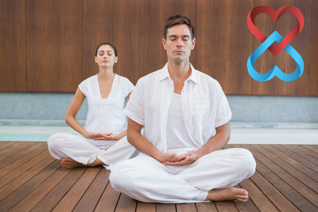 uomo rosso: Peaceful couple in white sitting in lotus pose together against linking hearts