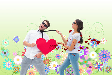 Brunette pulling her boyfriend by the tie against digitally generated girly floral design photo