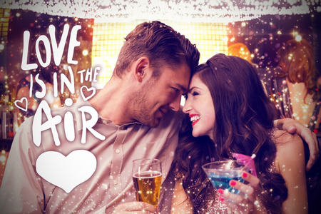 Cute couple drinking against love is in the air photo