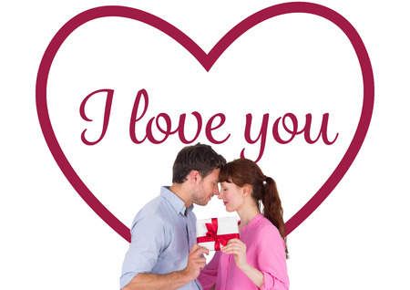 Loving couple holding a gift against valentines love hearts photo