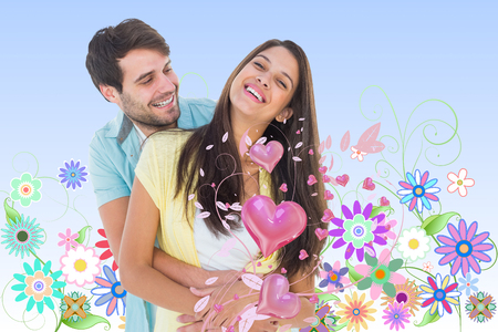 girly: Happy casual couple smiling and hugging against digitally generated girly floral design