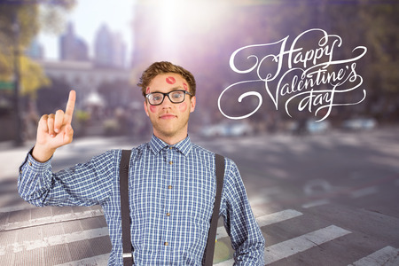 Geeky hipster covered in kisses against blurred new york street photo
