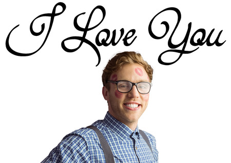 Geeky hipster covered in kisses against i love you photo