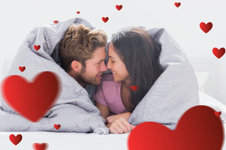 hair wrapped up: Couple wrapped in the duvet against hearts