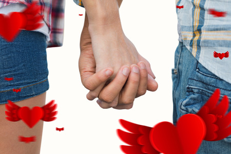 hot pants: Couple in check shirts and denim holding hands against hearts
