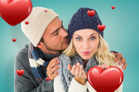 Attractive couple in winter fashion  against blue vignette background photo