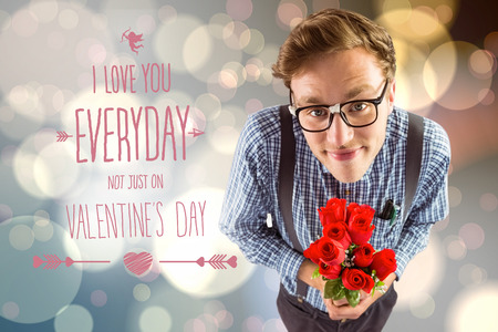 Geeky hipster holding a bunch of roses against light glowing dots design pattern photo