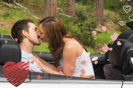 smooching: Young couple smooching on the backseat against heart Stock Photo