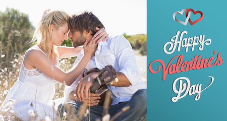 serenading: Handsome man serenading his girlfriend with guitar against cute valentines message Stock Photo