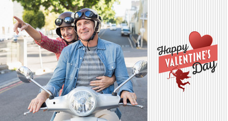 crash helmet: Happy mature couple riding a scooter in the city against happy valentines day