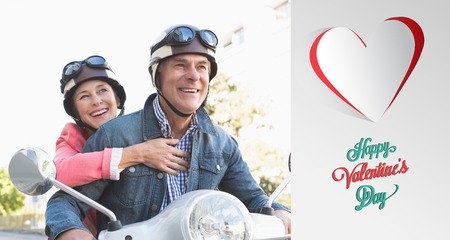 active lifestyle: Happy senior couple riding a moped  against cute valentines message