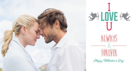 hair wrapped up: Cute smiling couple standing outside facing each other against i love you message