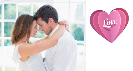 arms around: Loving young couple with arms around against love heart Stock Photo