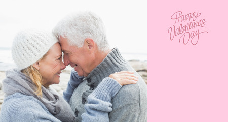 Side view of a romantic senior couple against happy valentines day photo