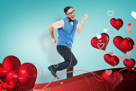 computer dancing: Geeky hipster dancing and smiling against blue vignette background