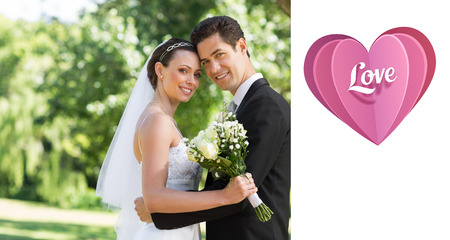 wed: Love heart against loving newly wed couple in garden Stock Photo