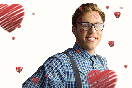 Geeky hipster covered in kisses against hearts photo