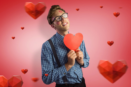 Geeky hipster covered in kisses against red vignette photo