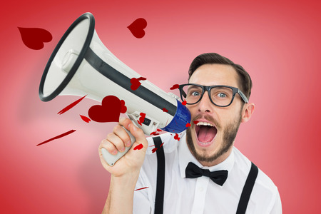 businessman using a megaphone: Geeky businessman shouting through megaphone against red vignette