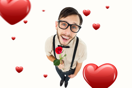 geeky: Geeky lovesick hipster holding rose  against hearts