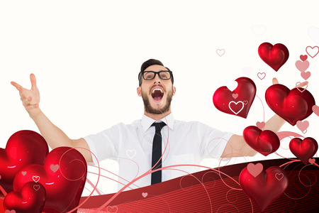 escapism: Geeky young businessman with arms out against valentines heart design
