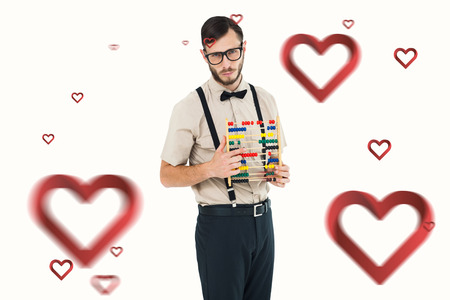 geeky: Geeky hipster holding an abacus against hearts Stock Photo