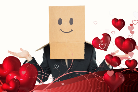 shrugging: Businessman shrugging with box on head  against valentines heart design