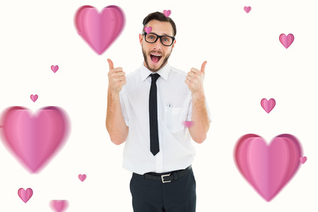 cheesy grin: Geeky young man showing thumbs up against hearts Stock Photo