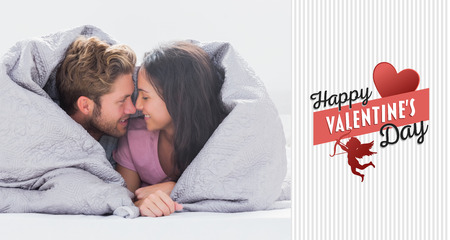 hair wrapped up: Couple wrapped in the duvet against happy valentines day