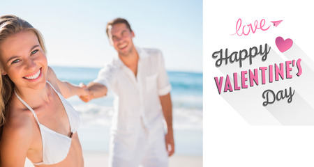 Pretty woman smiling at camera with boyfriend holding her hand against cute valentines message photo