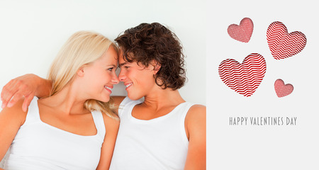 In love couple looking at each other against cute valentines message photo