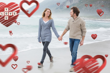 Couple holding hands and walking at beach against love you tiles photo