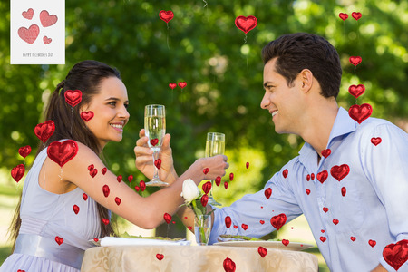champagne flutes: Couple with champagne flutes sitting at outdoor café against cute valentines message