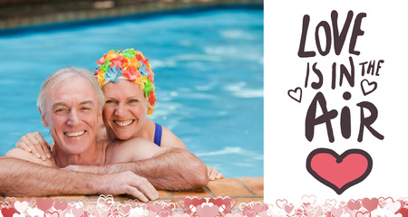 Happy mature couple in the swimming pool  against love is in the air photo