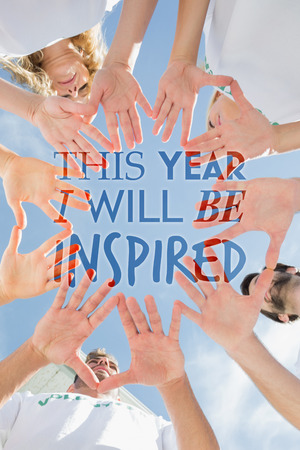 volunteer: Volunteers with hands together against blue sky against i will be inspired