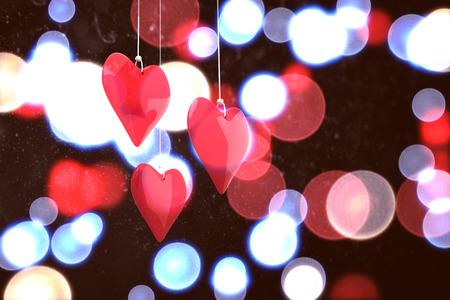twinkling: Love hearts against twinkling red and blue lights Stock Photo