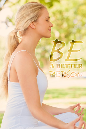 Side view of ponytailed calm woman meditating sitting in a park against be a better person photo