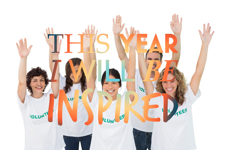 inspired: Group of volunteers raising arms against i will be inspired Stock Photo