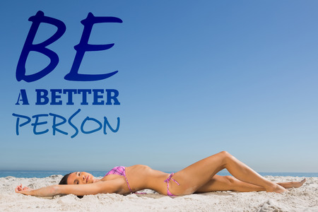 sun bathing: Slim young woman posing while sun bathing against be a better person
