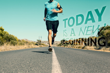 jogging: Athletic man jogging on open road against today is a new beginning Stock Photo
