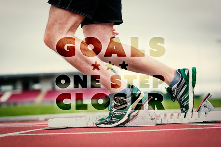 closer: Low section of a man ready to race on running track against goals one step closer Stock Photo