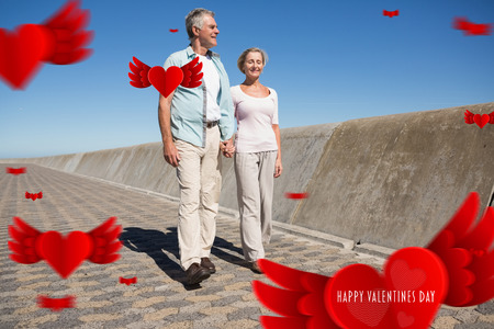 chinos: Happy senior couple walking on the pier against cute valentines message