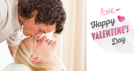 fiance: Close up of a man kissing his fiance on the forehead against cute valentines message Stock Photo