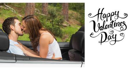 smooching: Young couple smooching on the backseat against happy valentines day Stock Photo