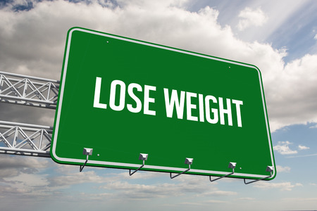 lose weight: The word lose weight and green billboard sign against sky