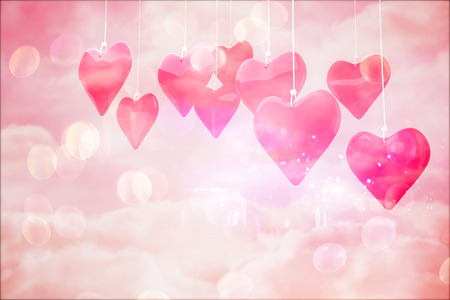 girly: Love hearts against digitally generated pink girly design Stock Photo