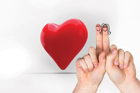 fingers crossed: Fingers crossed like a couple against red heart